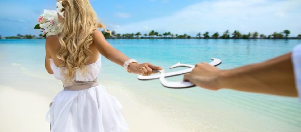 Young couple honeymoon on Maldives